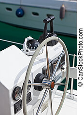 Sailing yacht control wheel and implement. Vertical shot ...