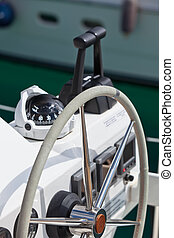 Sailing yacht control wheel and implement. Vertical shot...