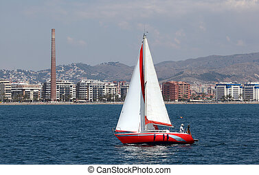 Sailing yacht in front of Malaga, Andalusia Spain