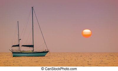 Sailing yacht in the bay. Tropical sunset