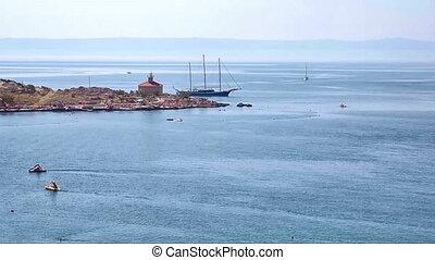 Sailing yacht near the lighthouse