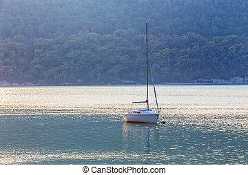 Sailing yacht on beautiful lake