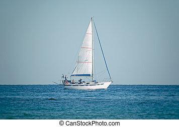 Sailing yacht on the high seas