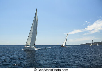 Sailing yacht on the race in a sea.