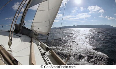 Sailing yacht on the race in sea