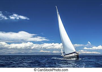 Sailing. Yachting. Sailboats participate in sailing regatta...