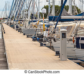 Sailing Yachts Parked in a Harbor