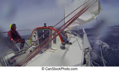 Sailor at the helm - Single handed sailor steering his small...