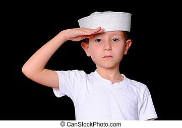 Sailor Boy - Young boy in a sailor\'s cap isolated on black