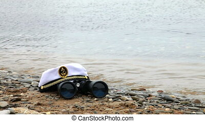 Sailor cap and binoculars - sailor cap and binoculars on the...