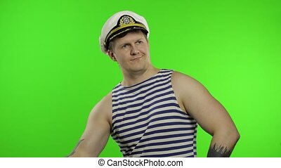 Sailor man making weightlifting with dumbbell. Seaman guy in...
