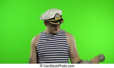 Sailor man making weightlifting with dumbbells. Seaman guy ...