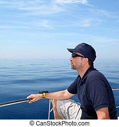 Sailor man sailing boat blue calm ocean water Mediterranean ...