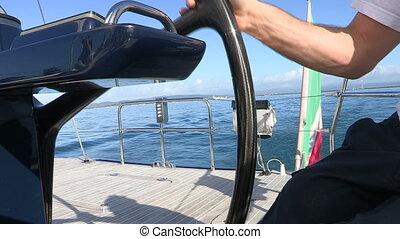 Sailor manoeuvring  steering wheel