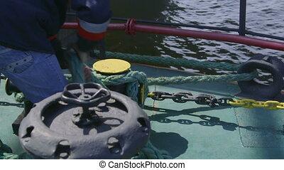 Sailor mooring  vessel at offshore gas production platform