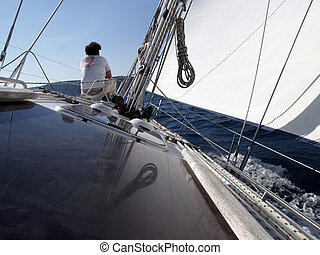 sailor on the prow - pulling rope