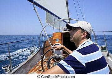 Sailor sailing in the sea. Sailboat over mediterranean blue saltwater