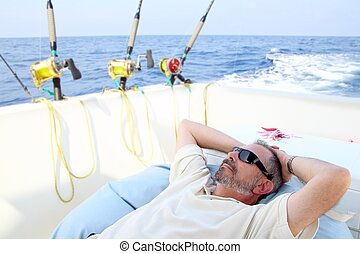 Sailor senior fisherman relax on boat fishing sea - Sailor...