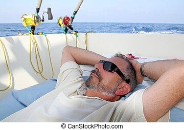 Sailor senior fisherman relax on boat fishing sea