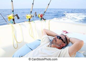 Sailor senior fisherman relax on boat fishing sea - Sailor...