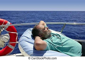 Sailor senior man having a rest on summer boat