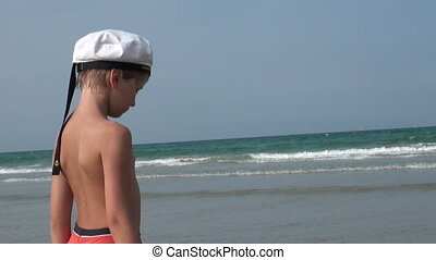 Sailor - The boy on the beach in a sailor hat smiling...