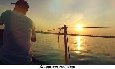Sailor with paddle surf in slowmotion at the amazing sunset...