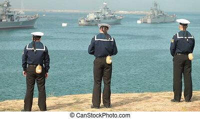 Sailors looking at navy ships