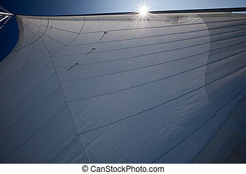 Sails - A detail of rigging, sails filled with wind.