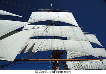 Sails from historic boat in San Diego, against clear blue...