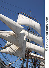 sails - white billowing sails from a vintage tall ship