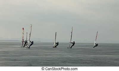Sails winter windsurfing - Sails over ice sea, winter...