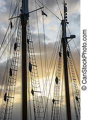 Sailship poles in the setting sun