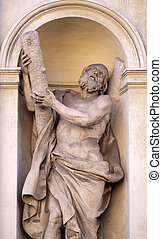 Saint Andrew by Luca Breton on the facade of Santi Claudio e...