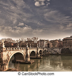View of the bridges over the river Tiber in Rome, Italy. In view: Ponte Saint Angelo.