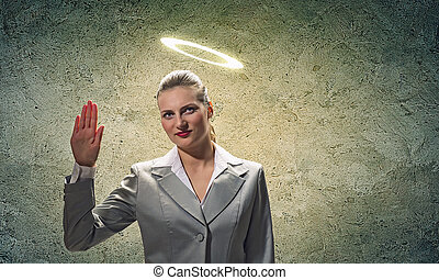 Saint businesswoman - Image of businesswoman with halo above...