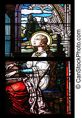 Saint Cecilia, stained glass in Minoriten kirche in Vienna, Austria on October 11, 2014.