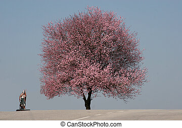 Saint Florian and tree in bloom in the earliest springtime