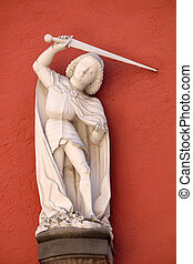 Saint George statue on the house facade in Wurzburg, Bavaria, Germany