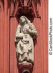 Saint James the Less statue on the portal of the Marienkapelle in Wurzburg, Bavaria, Germany