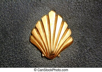 Saint James way shell golden metal on streets soil stone...