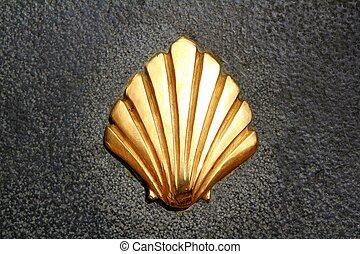 Saint James way shell golden metal on streets soil stone ...