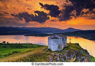 Sunset over Saint Joan Letni chapel near Pchelina dam, Bulgaria