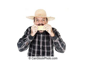 Man eating corn in saint john holiday