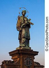 Saint John of Nepomuk statue on Charles Bridge in Prague, Czechia (Czech Republic).