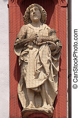 Saint John the Baptist statue on the portal of the Marienkapelle in Wurzburg, Bavaria, Germany