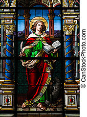 Saint John the Evangelist. Stained glass window created by F. Zettler (1878-1911) at the German Church (St. Gertrude's church) in Gamla Stan, Stockholm.