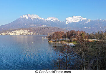 Saint Jorioz beach and mountains on Annecy lake