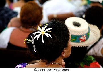 RAROTONGA - SEP 16:Prayers at Saint Josephs Cathedral on Sep 16 2013.94% of Cook Islanders associated themselves with a faith. Saint Josephs Cathedral is the only Catholic Cathedral in the Cook Islands.