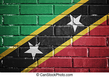 Saint kitts and nevis flag on a textured brick wall